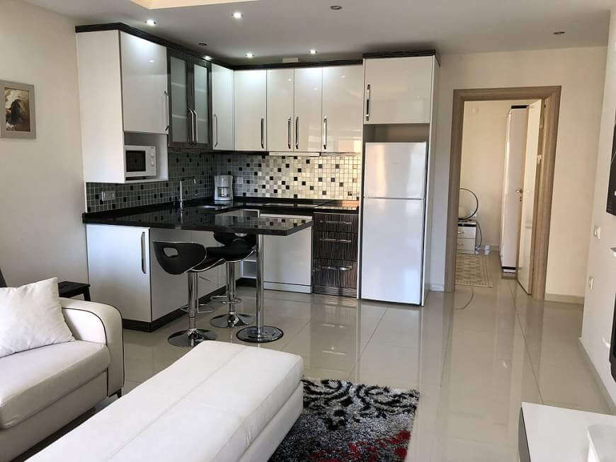 Tilava keittiö ja olohuone: Villa Alanya. Real estate Alanya.